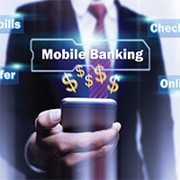 Man holding a phone with mobile banking hovering over the phone.